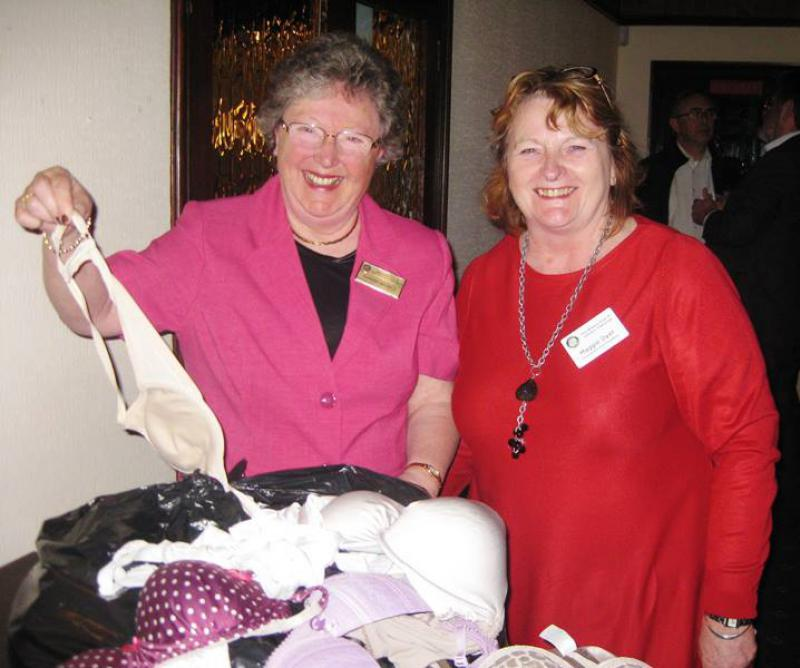 BUST -  help women in the 3rd world and breast cancer research. - Pres Sandra and Maggie Dyer showing the wares collected at District 1260