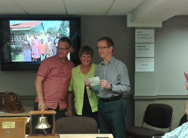 What we are doing internationally - Presentation of cheque to the Rowleys