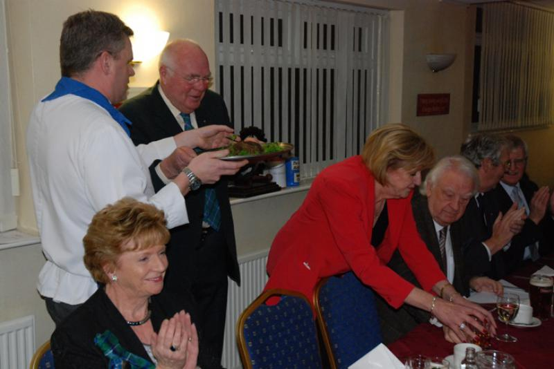 BURNS NIGHT - President Anne making room for  the haggis but careful not to spill to wee dram.