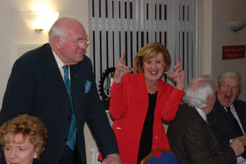 BURNS NIGHT - President Elect Ron is having a good laugh. President Anne is measuring something.