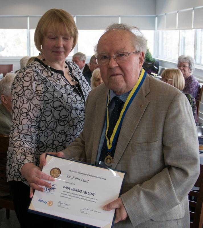 World's Greatest Meal and Surprise for Rtn. John Paul - Dr. John Paul displays his Paul Harris Fellowship Certificate