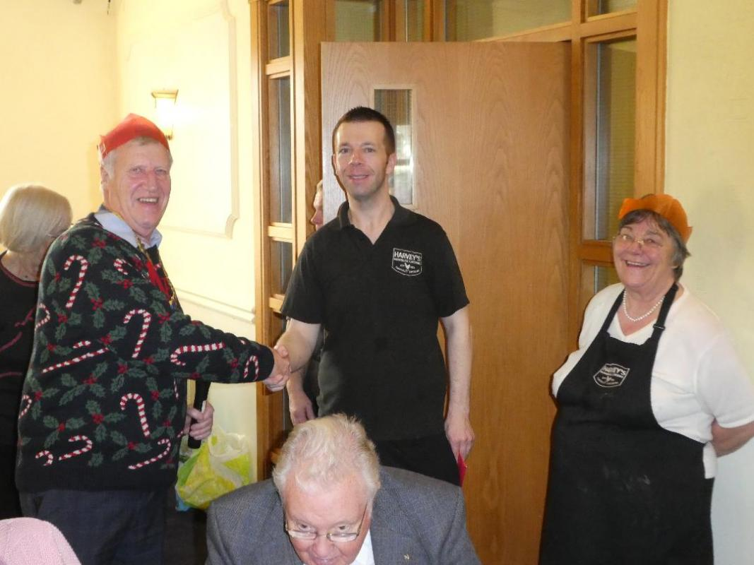 Christmas Lunch - President Michael presenting Harvey's Catering  Staff with their Christmas Donation