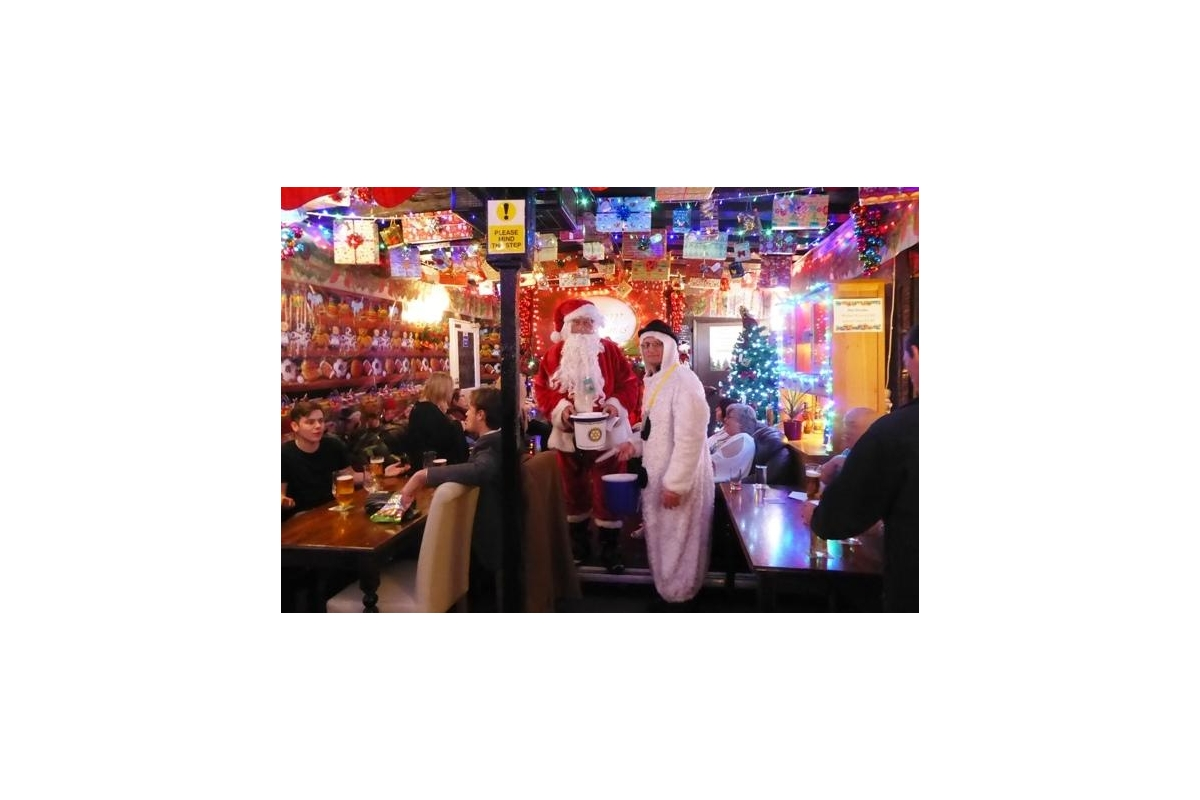CHRISTMAS COLLECTIONS 2018 - Father Christmas and one of his snowmen collecting in well-decorated  Anchor pub.
