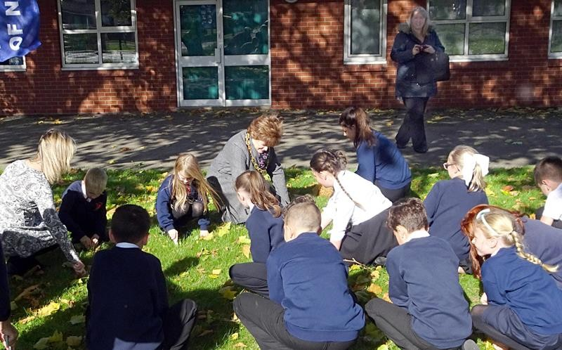 Raising awareness of Rotary's aim to eradicate Polio - Pupils busy planting