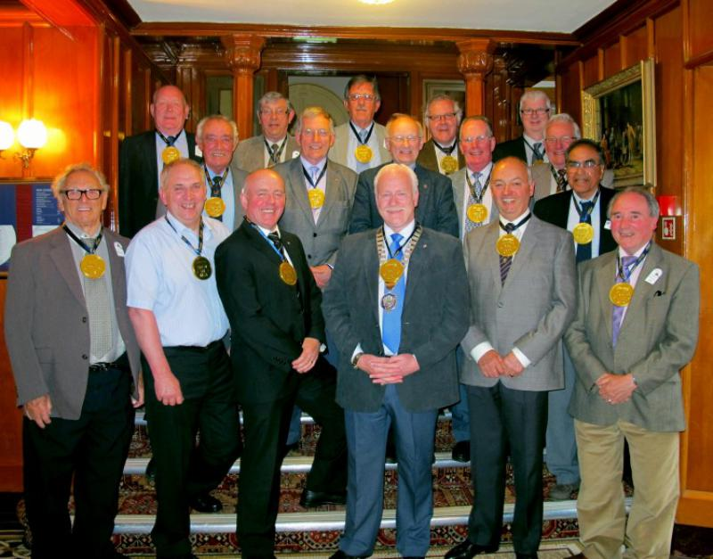 Rotary Club of Carluke - President Archi Ralston with Carluke Rotarians wearing -Your the Best- Gold (chocolate) Medals