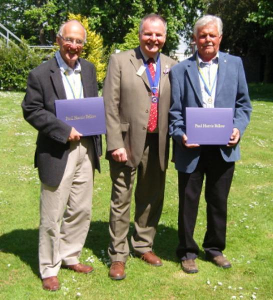 Rotary Awards - District Governor Elect, Kevin Walsh congratulates the new Paul Harris Fellows, Alan & Rod