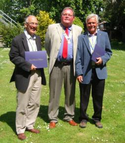 Rotary Awards - President Hughie Stamper congratulates the new Paul Harris Fellows, Alan & Rod