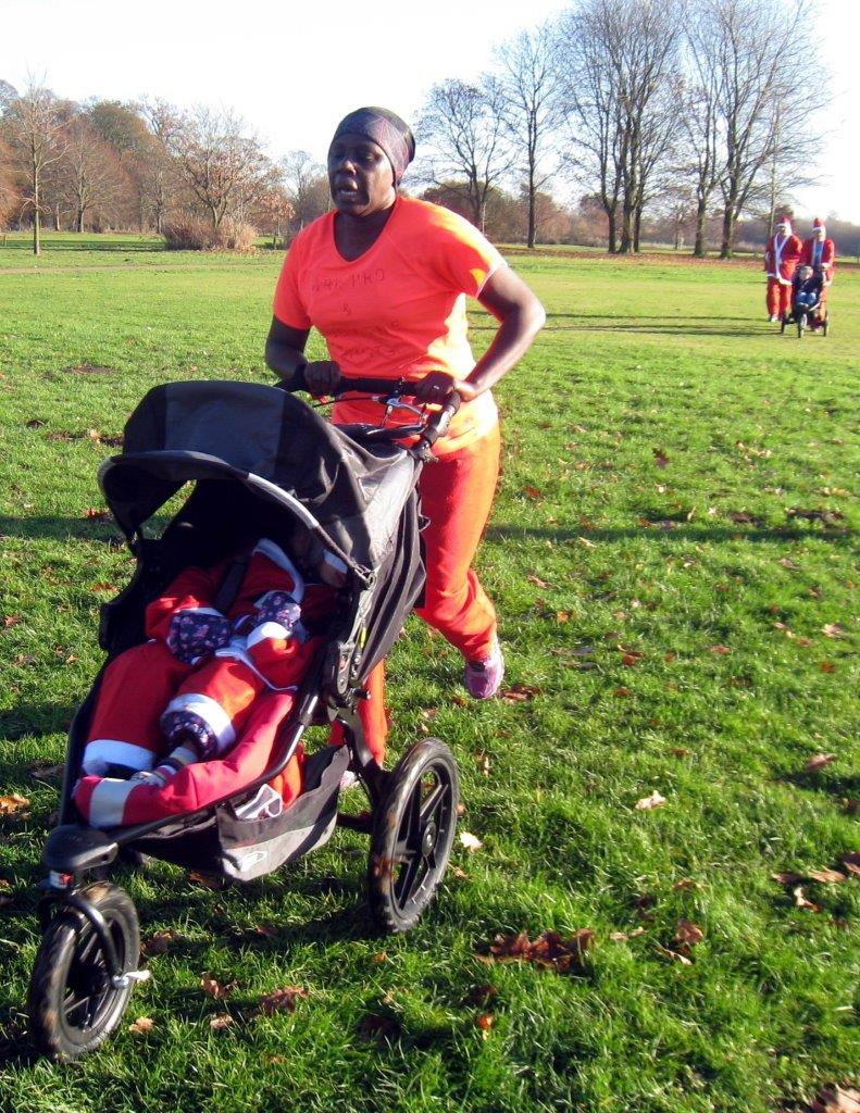 Rotary Fun Run in the park - 2nd Pushchair to cross the finishing line