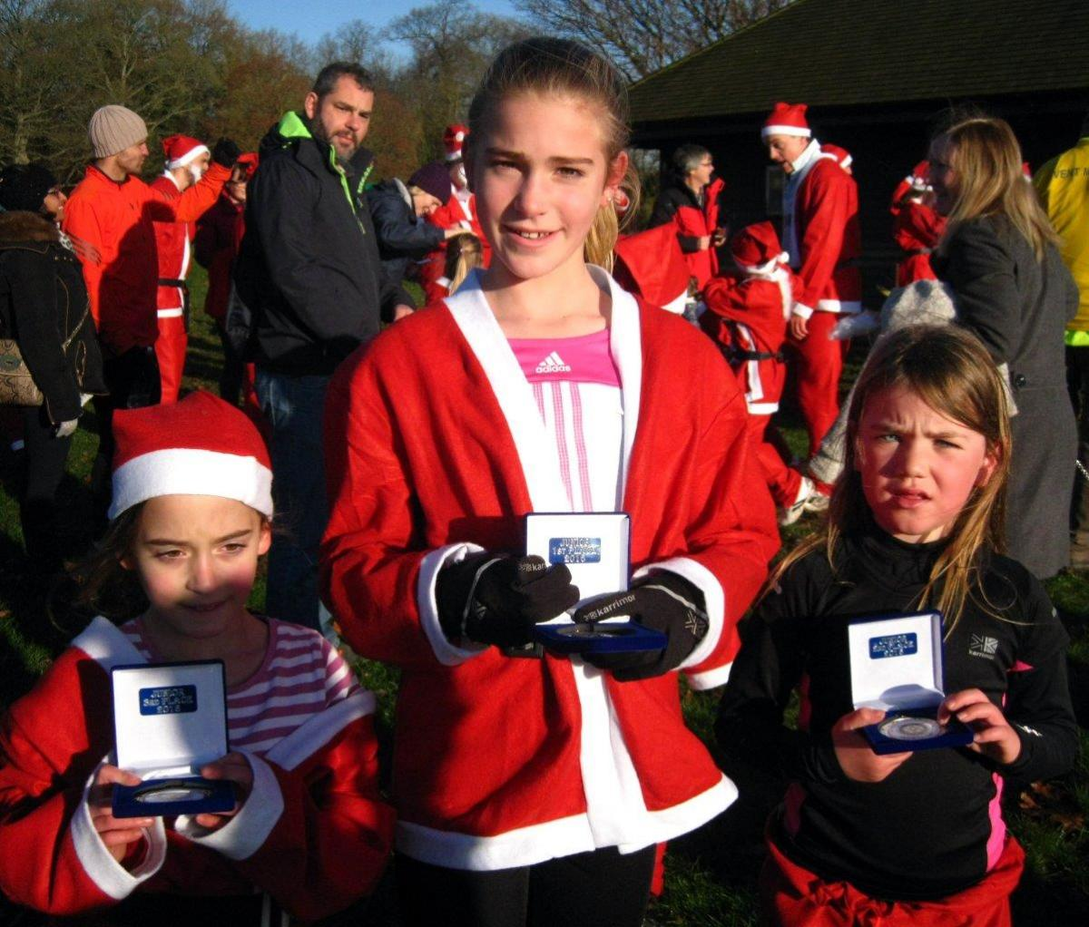 Rotary Fun Run in the park - Gold winner Sophie Bates (centre), Silver to Lily Riley-Flinders (right) and Bronze to Abigail Skinner(left)