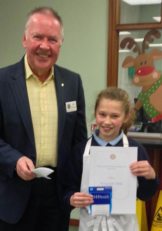 Rotary Young Chef Competition - Rtn. John Whitehead presents the Gold certificate and book token to Mae