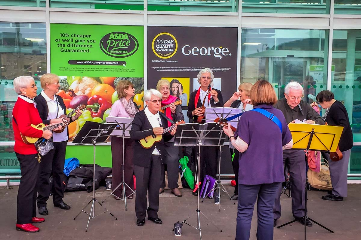 Book Giving at Asda - The ukulele band created a fun atmosphere.