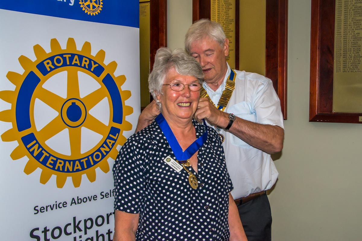 Club Assembly - Clyde presents Linda with her Past President's chain.