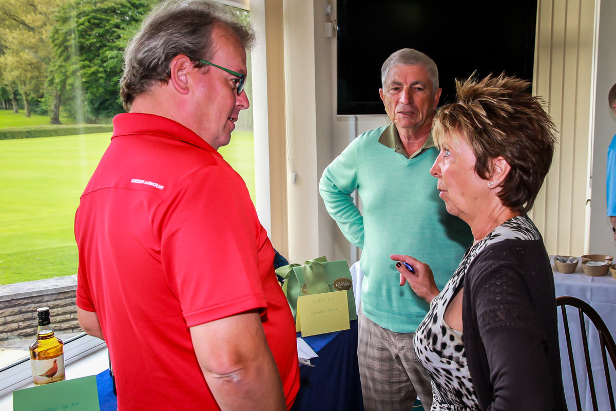 Charity Golf Day - Mary selling her raffle tickets.