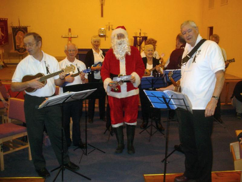 St Thomas Christmas Party - Santa and the band.