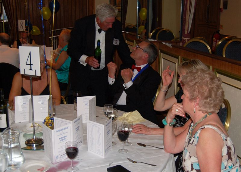 25th Anniversary Charter Celebration - Tony has an argument with the wine waiter.