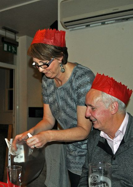Christmas Party - Jane selling raffle tickets.