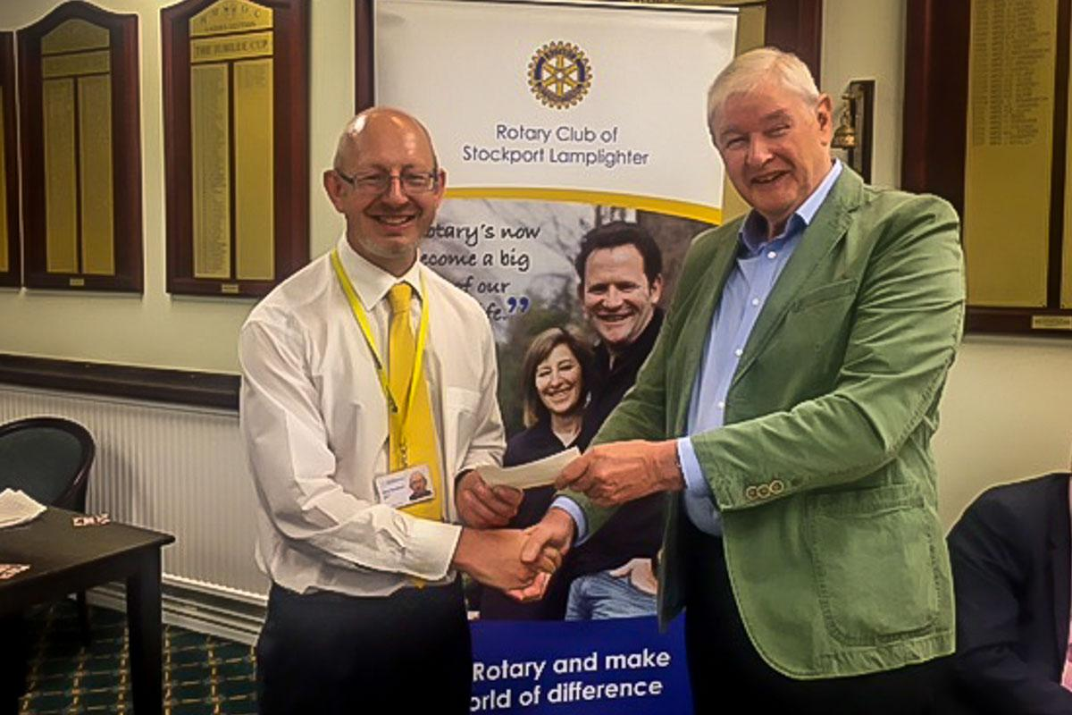 Speakers evening - Clyde presents a cheque.