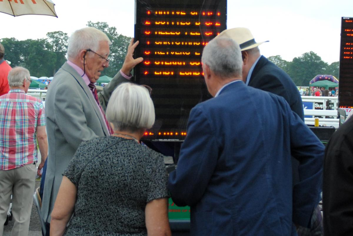 Rotary at the Races - collecting the winnings