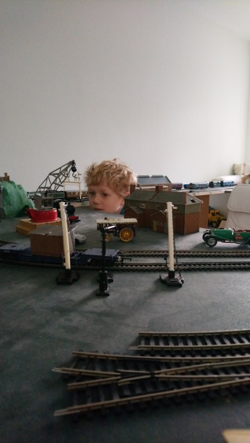 Model Railway's Youngest Ever Exhibitor. - Oliver working out next improvement to his network