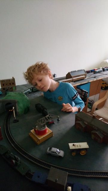 Model Railway's Youngest Ever Exhibitor. - Oliver adding to his rail layout