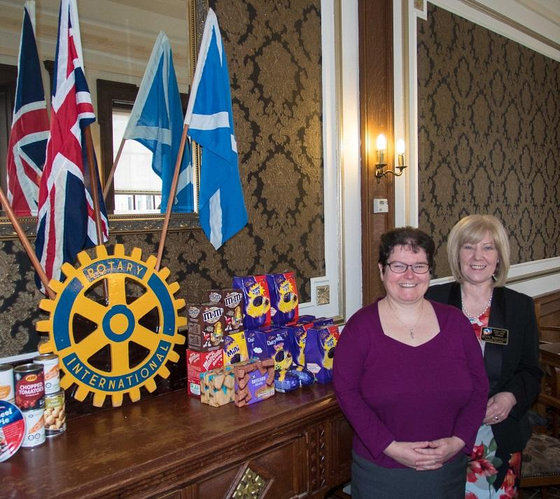 Rotarians donate to the URC Food Angel Foodbank - Rtn. Rev. Branwen Rees with Secretary Betty