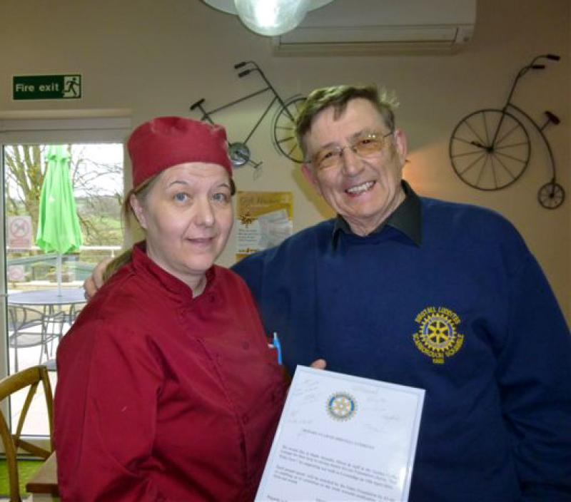 Afternoon Tea Walk for End Polio Now - Robert and Cafe owner with End Polio Certificate.