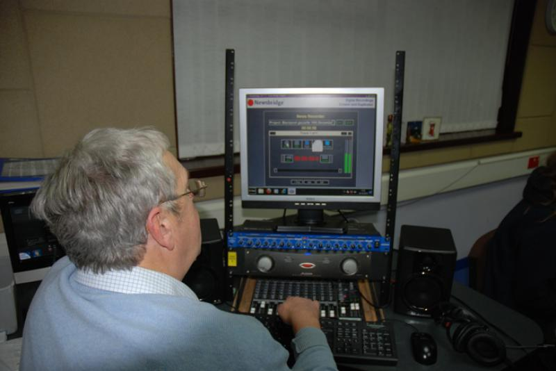 THE TALKING NEWSPAPER TEAM - Ron Greenhough at the controls.