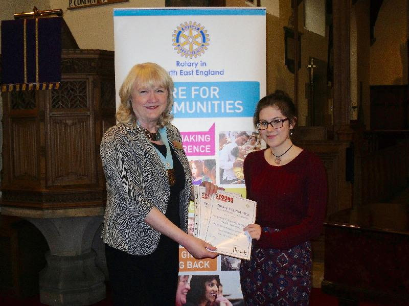 Young Musician 2015 - District Final - Rosie Shaw, winner of the vocalist category, receives her certificate from DG Jean Thompson