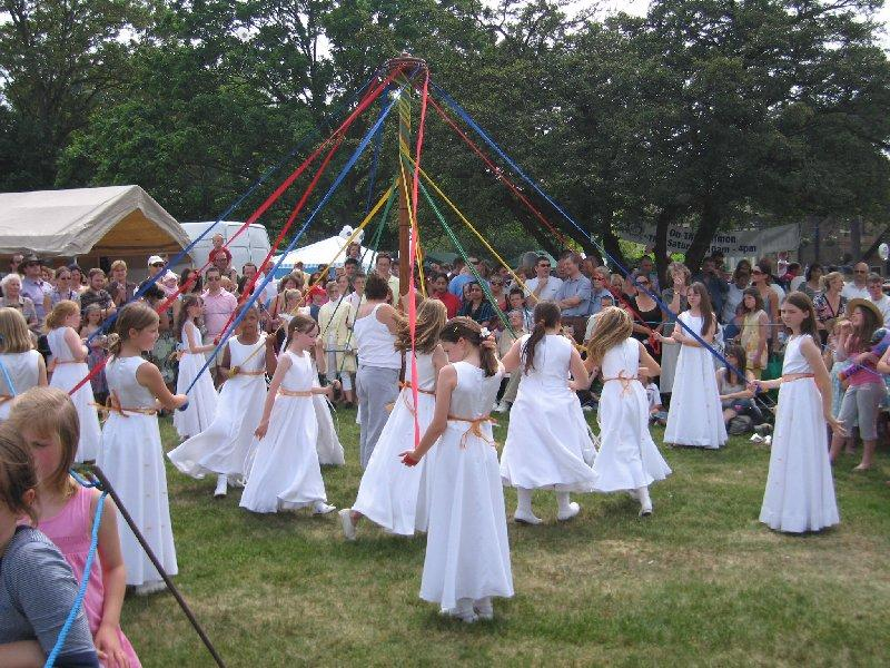 About Our Club - The Chislehurst May Queen dancers, performing at the annual Summer fair organised by our club.