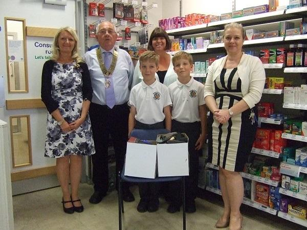 Walton-le-Dale Primary School Rotakids - Pupils handing over used glasses collected by the school to Boots the Chemist in Bamber Bridge for use in the Third World