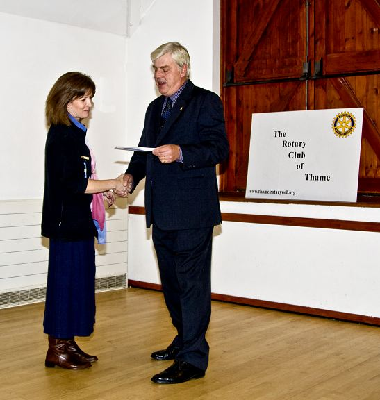 Presentation of Cheques 2008 -  Cheque being presented to Thame Guide leader Linda Newton.