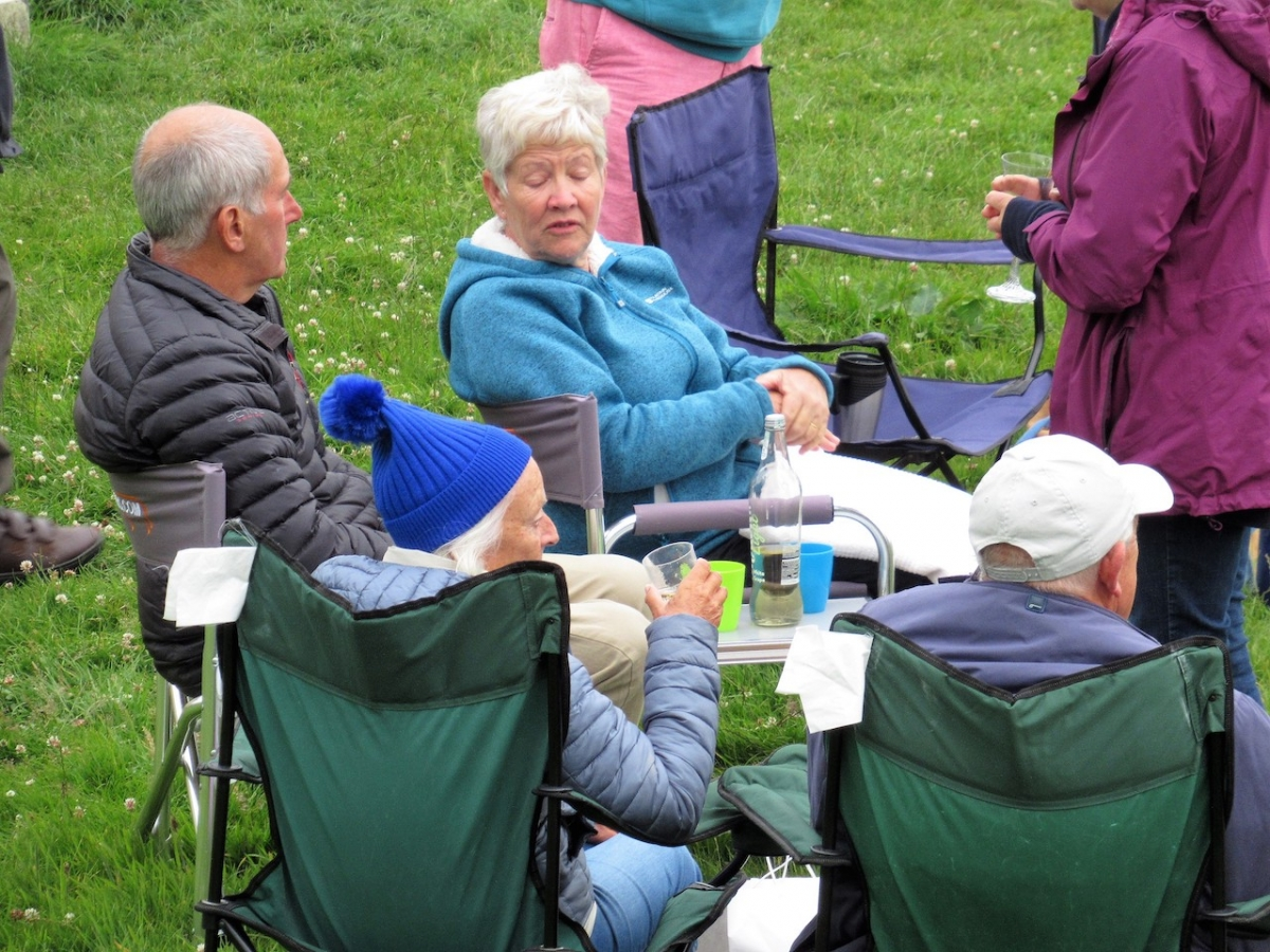 Club meets outdoors in summer(!) weather - Rotary 14