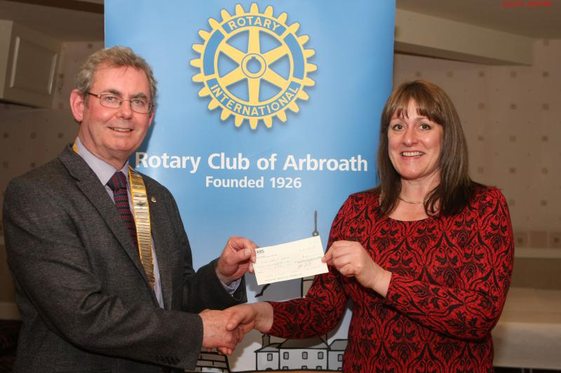 Cheque presentations - Ian Lamb presents a cheque to Judith Leslie, Manager of Angus Care and Repair - April 2014