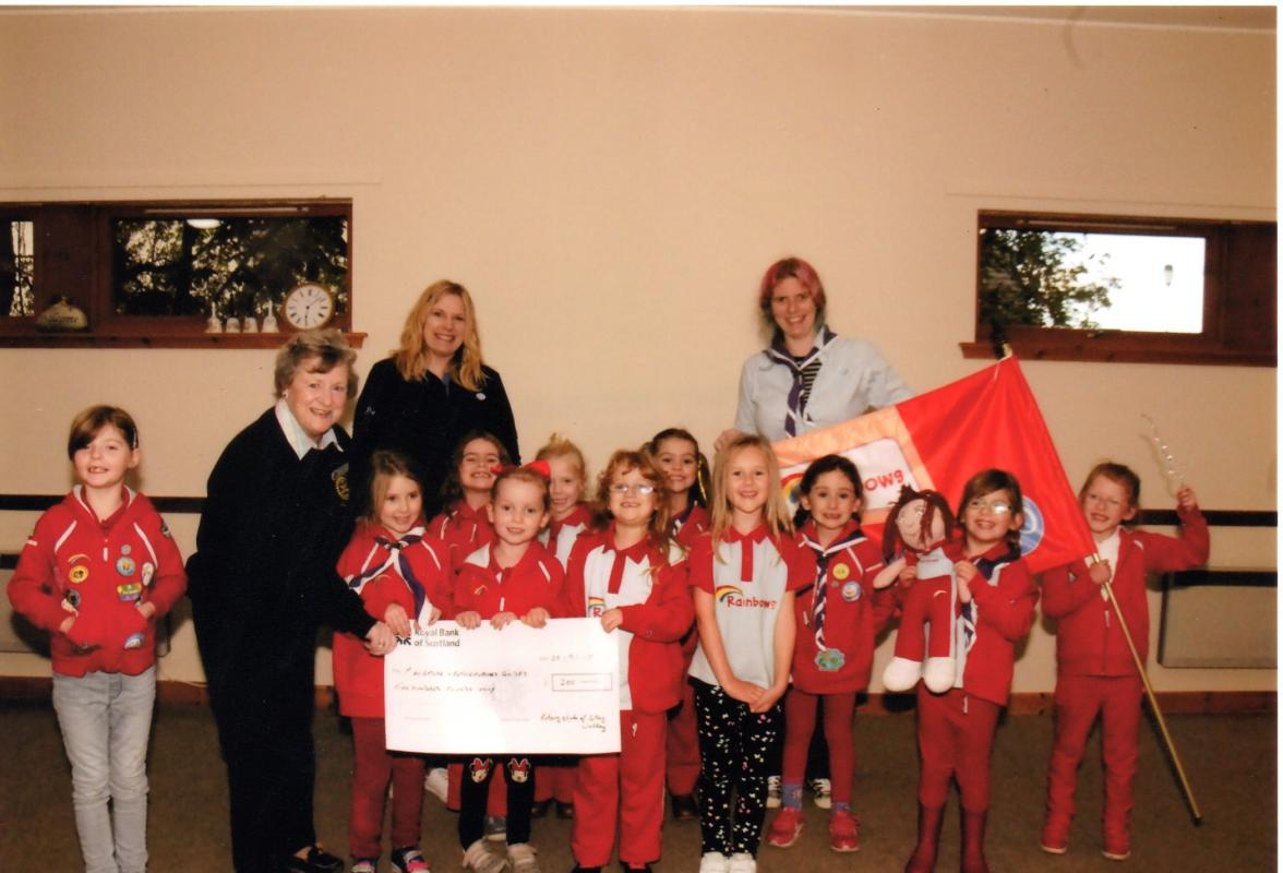 Recent Club Activities - The Club handed over a cheque for £250 to the local Brownies to thank them for helping sell tickets for the Duck Race.