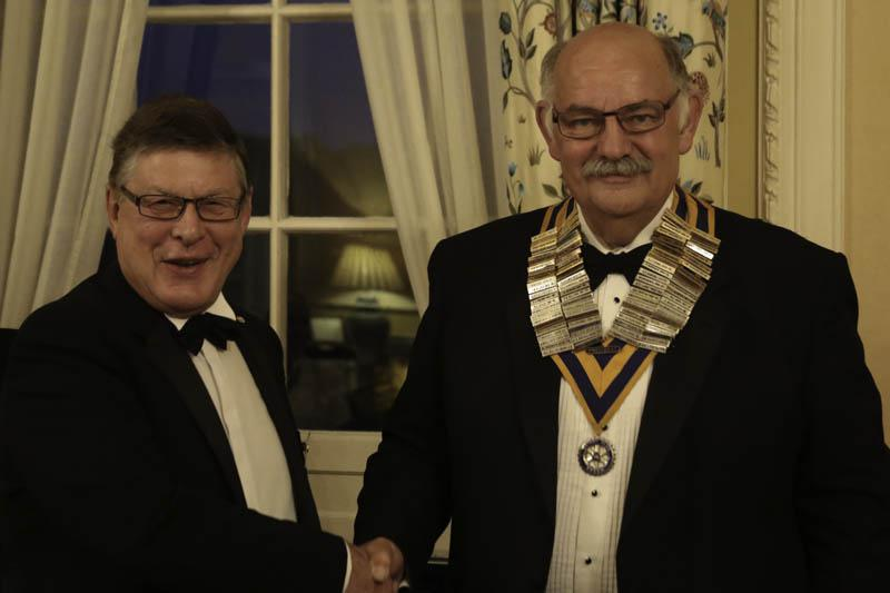 A new Rotary Year begins - Clive welcomes Richard as the new Hon. Secretary