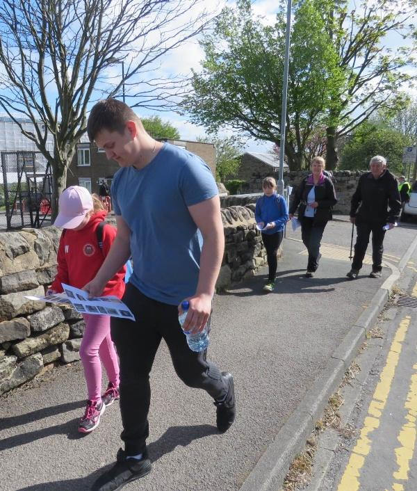 Annual Sponsored Charity Walk - Map in hand and concentration personified