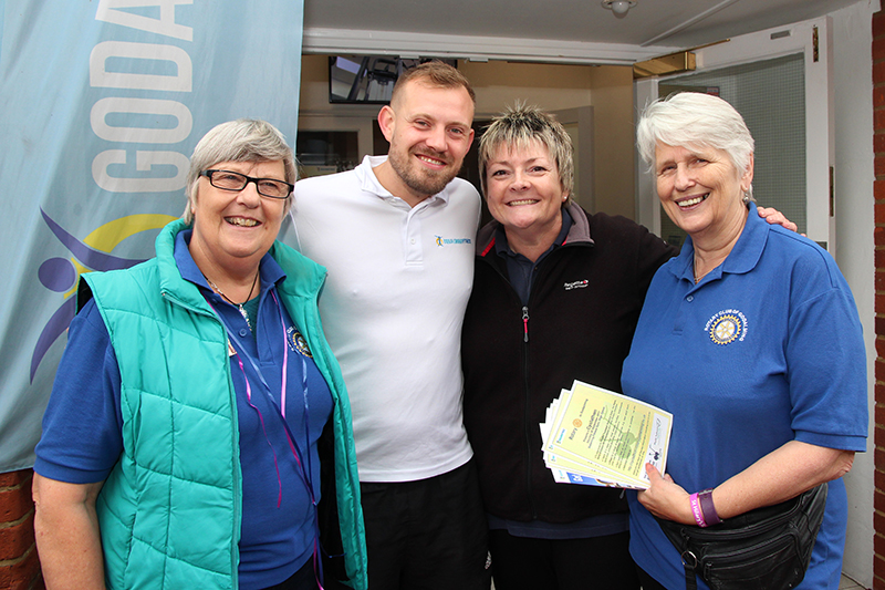 A CYCLATHON in Godalming - Rtns Heather, Jane and Vivien with GFG manager Pete