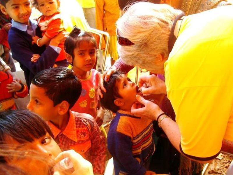 Charities we have or are supporting - Rtn Sue in administers Vaccine in India