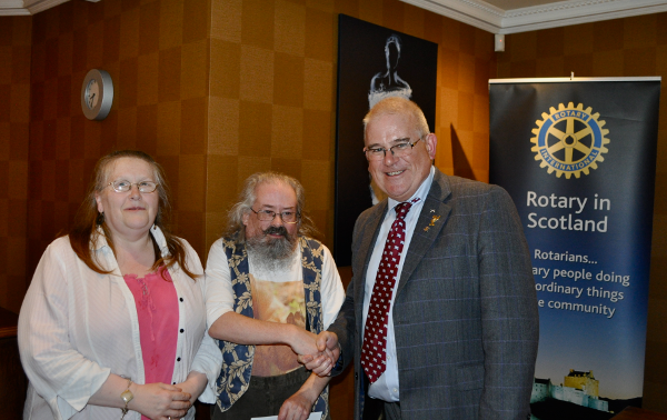 2014 Skye Rotary Annual Awards Dinner - Sadie Gillan and Niall Gordon receive their 100 pounds award for their musical band which entertains at old folks' homes on a voluntary basis.