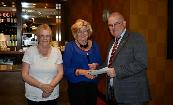 2014 Skye Rotary Annual Awards Dinner - Marion MacArthur and Dolly Robertson receive this 200 pounds award. The group visits the An Arcasaid care home, Broadford each week, organising speakers and musicians.