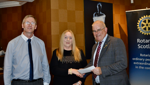2014 Skye Rotary Annual Awards Dinner - Lynne and Andrew Kearns receive their 200 pounds award. The food bank provides essential support for those who have fallen on very hard times.