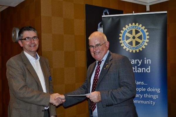 2014 Skye Rotary Annual Awards Dinner - Rotarian Graham Smith accepts 200 pounds on behalf of Helping Hands. This is a Portree-based project providing food hampers and children's presents for vulnerable families at Christmas.