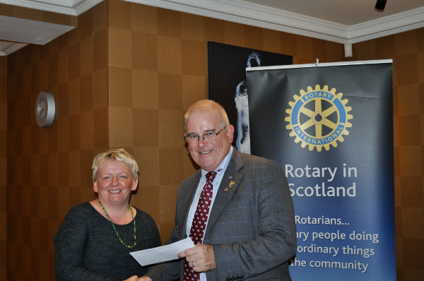 2014 Skye Rotary Annual Awards Dinner - Jacquie Murchison receives this 500 pounds award. The Hall honours the men of Skeabost who fell in WWII and the Palestine Conflict.