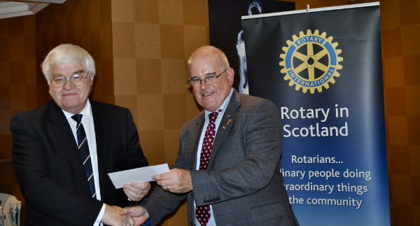 2014 Skye Rotary Annual Awards Dinner - The Rev John MacLean receives this 500 pounds award for Dion Skye. The charity helps those in north Skye with alcohol addiction and substance abuse.