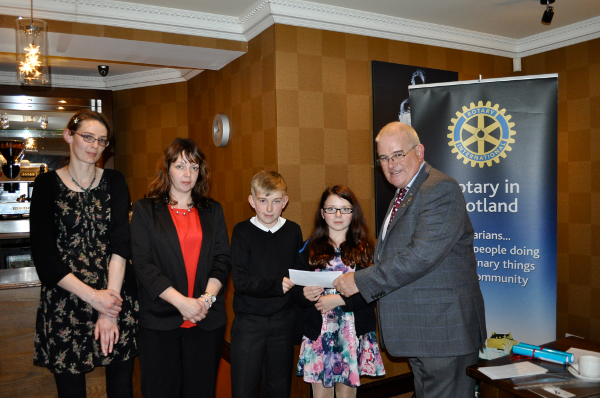 2014 Skye Rotary Annual Awards Dinner - Fiona Johnston, Dulcie Spencer and Young Carers Cameron Godfrey and Billie Baillie receive their 500 pounds award. Young Carers help a family member with chronic illness or other problem.