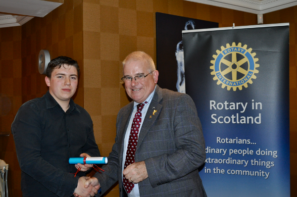 2014 Skye Rotary Annual Awards Dinner - Sim Lewis receives his scroll for this 50 pounds award for the best technology pupil at Portree High School.