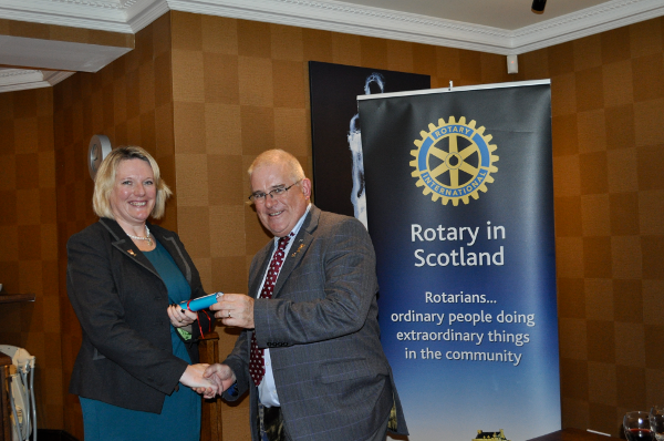 2014 Skye Rotary Annual Awards Dinner - Rotarian Lynn Fenemore-Ellis explains the 50 pounds award received by Claire MacDonald, former pupil of Portree High School. The award is for exceptional community-related contribution.