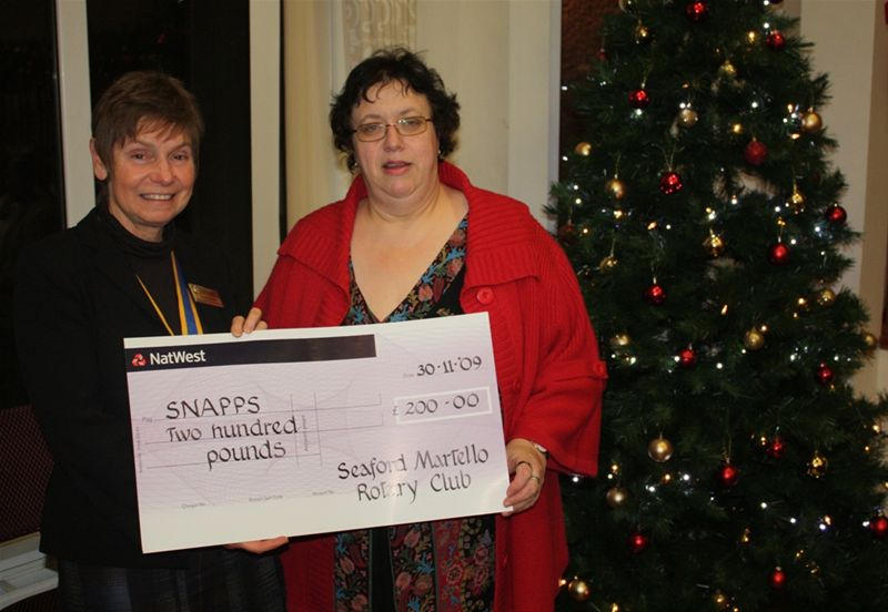 Cheque Presentation to Seaford Silver Band and SNAPPS - Pres.Linda presents a cheque to Rosemary Kemp,representative of the charity SNAPPS