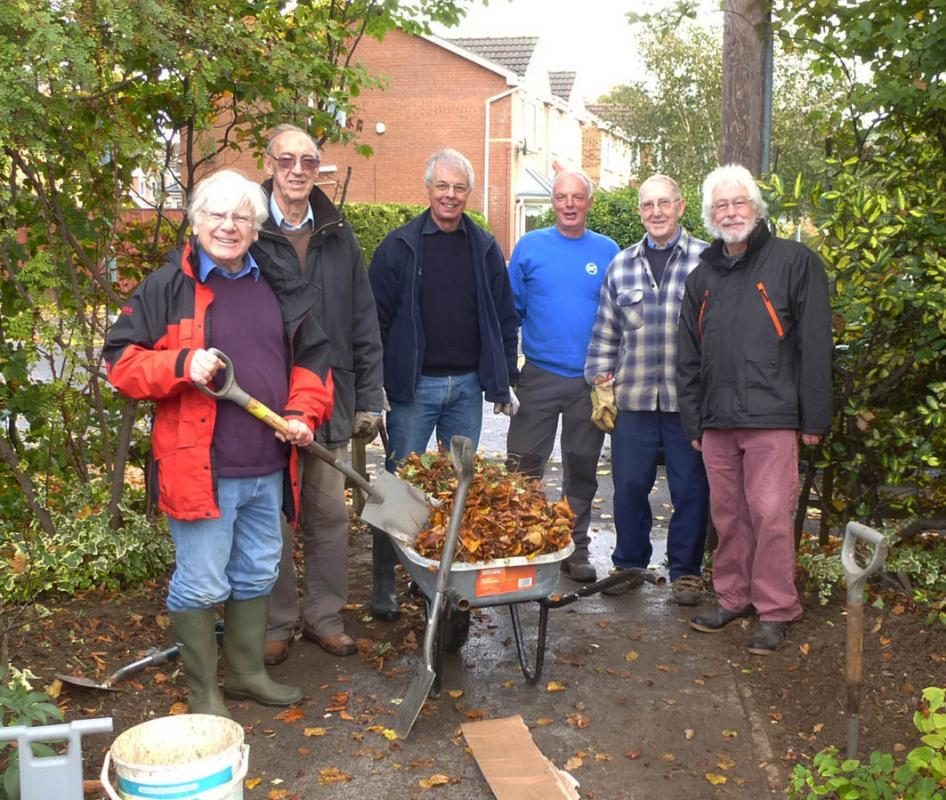 Planting Crocus bulbs at St Andrews Hospice - Rotarians and the volunteer gardeners.