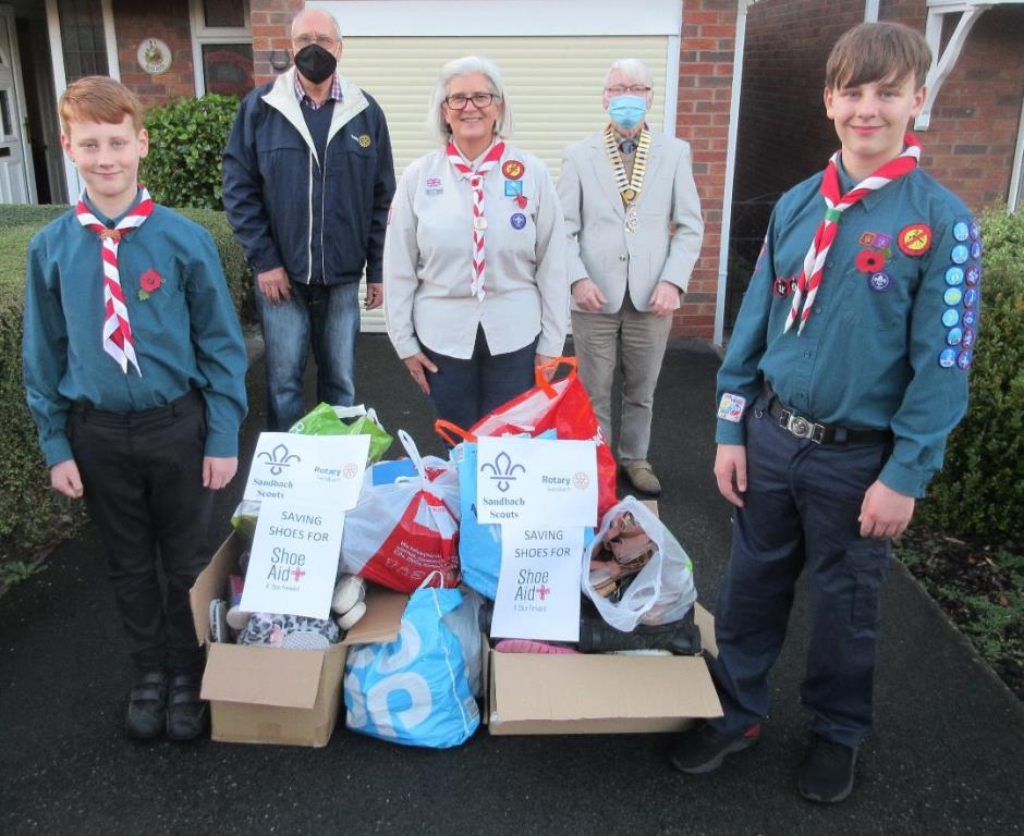 Sandbach Scouts supporting Shoe Aid - Two Scouts with the shoes collected and behind from left, Rtn. Eric Cowcill, Scouts Leader Lise Grasmeder and Rotary Club President Rtn. David Barringer
